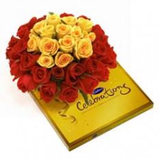 Cesta de 20 Rosas y Caja de Cadbury Pack Celebración
