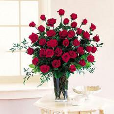 Encanto (12 rosas en un florero)
