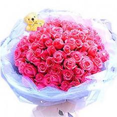 Ramo de 100 tallos Rosas de color rosa con un pequeño oso