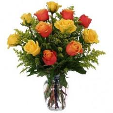 Incluye 12 rosas amarillas y naranjas
